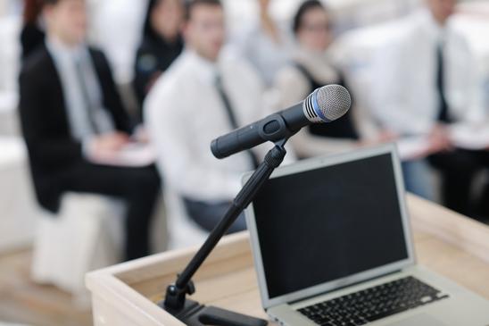 photodune-2297011-laptop-on-conference-speech-podium-xs